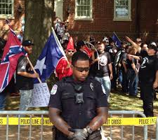 The Story Behind the Viral Photo of the Officer and the KKK