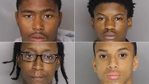 Four charged, identified in killing of Baltimore County, Maryland police officer