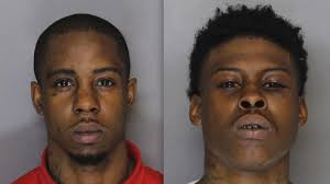Two Brothers charged in the  fatal shooting of innocent bystander